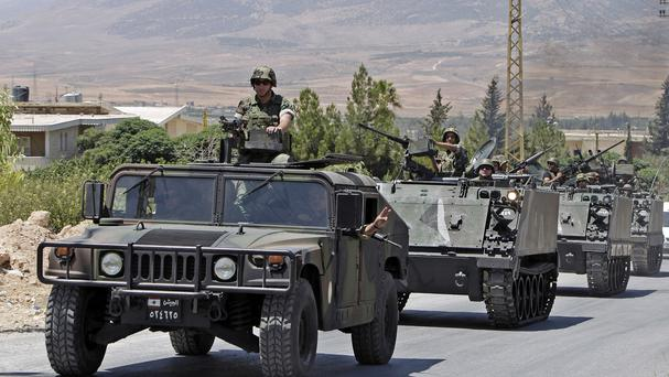 Lebanese army reinforcements arrive at the outskirts of Arsal (AP)