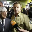 Formula One boss Bernie Ecclestone leaves the regional court in Munich (AP)