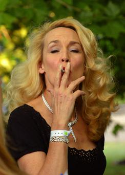 File photo dated 09/07/13 of Jerry Hall smoking a cigarette, as she she has held on to her looks despite doing all the wrong things, such as smoking and boozing. PRESS ASSOCIATION Photo. Issue date: Wednesday August 6, 2014. The Texan model has also ruled out dabbling with cosmetic procedures such as Botox to hold back the hands of time. See PA story SHOWBIZ Hall. Photo credit should read: Anthony Devlin/PA Wire