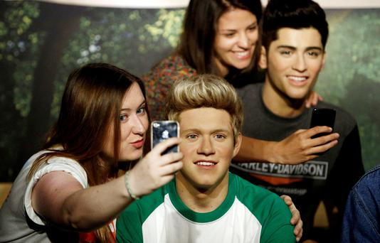 Becky Griffiths (left) takes a selfie with the wax figure of Niall Horan of One Direction following a makeover at Madame Tussauds, central London