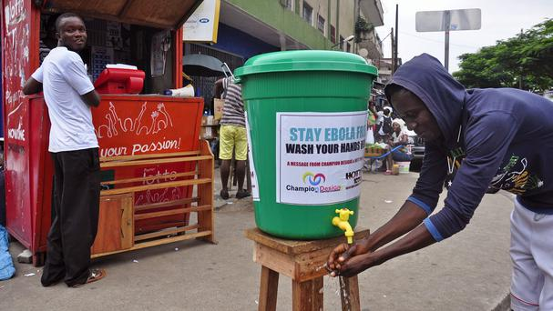 A man washes his hands in a attempt to stop the spread of the deadly Ebola virus in the city of Monrovia, Liberia (AP)