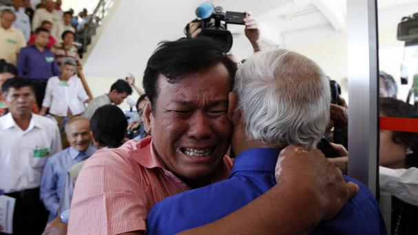 Cambodian Khmer Rouge survivors Soum Rithy, left, and Chum Mey embrace after verdicts were announced at a war crimes tribunal in Phnom Penh (AP)