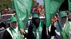 Hamas supporters gather for a rally in Gaza City that drew several thousand supporters (AP)