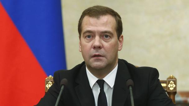 Russian premier Dmitry Medvedev announces sanctions at a Cabinet meeting in Moscow (AP/RIA Novosti, Dmitry Astakhov, Government Press Service)