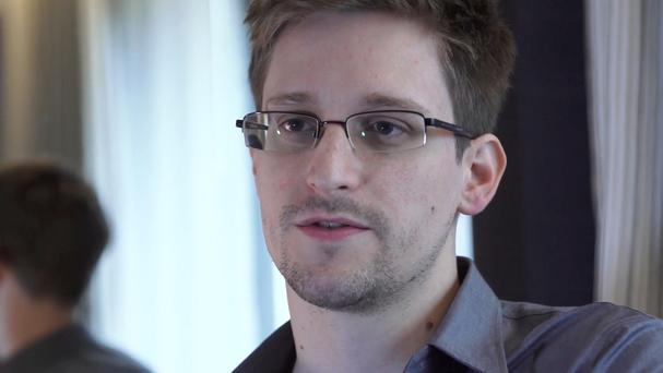 Edward Snowden worked as a contract employee at the National Security Agency and is wanted by the US for leaking details about once-secret surveillance programmes (AP/The Guardian, Glenn Greenwald and Laura Poitras)