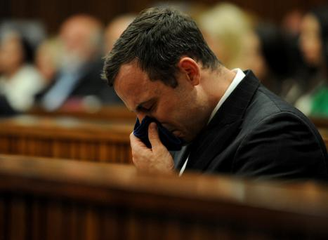 Oscar Pistorius reacting as he listened to state prosecutor summarise his evidence, during his court case, in Pretoria, South Africa, Thursday, Aug. 7, 2014.