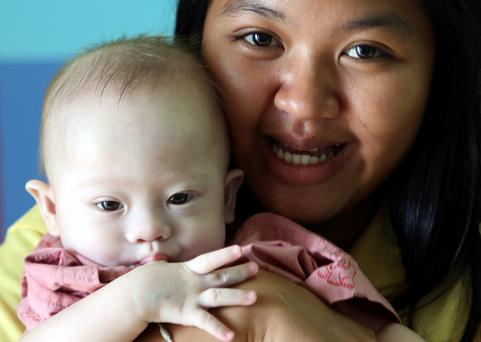 File photo:Thai surrogate mother Pattaramon Chanbua, a 21-year-old food vendor, poses with Gammy