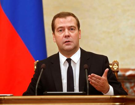 Medvedev said on Moscow was considering banning transit flights by airlines from the European Union and the United States to the Asia-Pacific region