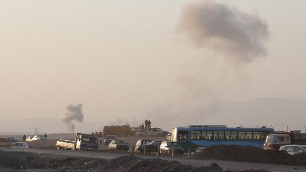 Smoke rises from airstrikes targeting Islamic State militants. (AP Photo/ Khalid Mohammed)
