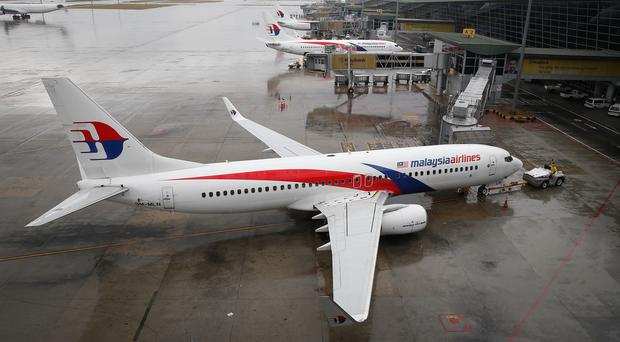 A Malaysia Airlines Boeing 737-800 plane sits on tarmac at Kuala Lumpur International Airport (AP)