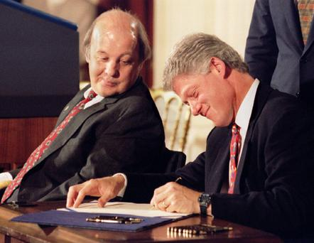 Law: Bill Clinton signs into law the Brady bill as former White House press secretary James Brady looks on in 1993