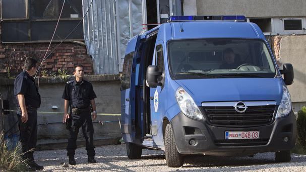Kosovo police officers guard the entrance of a makeshift mosque after a raid in the capital Pristina. (AP)