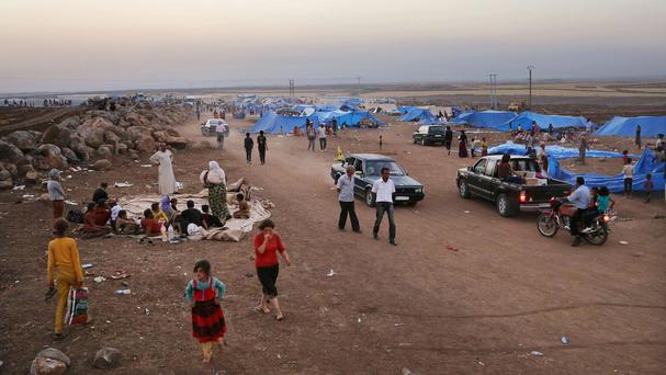 Displaced Iraqis from the Yazidi community settle at a camp in Syria. (AP Photo/Khalid Mohammed)