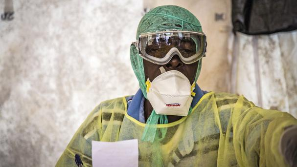 A health worker examines patients for Ebola inside a screening tent at the Kenema Government Hospital in Sierra Leone (AP)