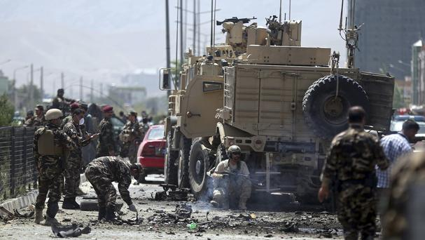 Afghan security forces search the site of a suicide attack in Kabul (AP)
