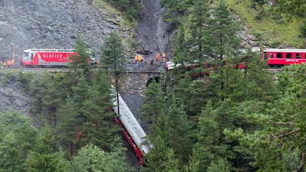 A derailed passenger train is pictured near Tiefencastel, Switzerland (AP/Keystone, Arno Balzarini)