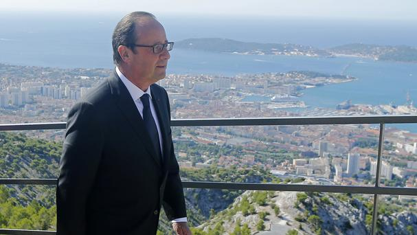 Francois Hollande arrives at a ceremony to pay tribute to the French resistance during the Second World War at the Mont Faron memorial in Toulon (AP)