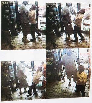 Still footage from a store robbery in Ferguson
