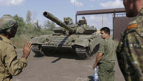 Pro-Russian rebels park a tank on their base near the town of Krasnodon, eastern Ukraine (AP)