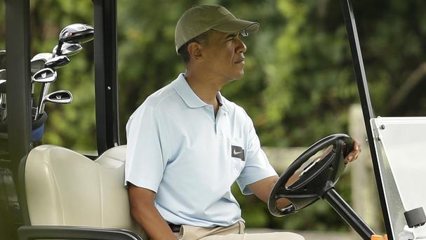 US president Barack Obama enjoys a golf session in Oak Bluffs, Massachusetts, on the island of Martha's Vineyard (AP)