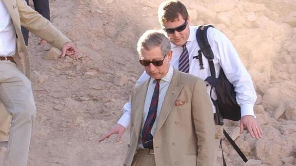 The Prince of Wales visits destroyed ramparts of the historic citadel which dominated the Iranian city of Bam before the devastating quake in 2006