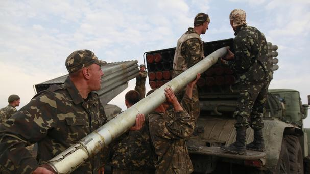 Ukrainian soldiers load a Grad missile during fighting with pro-Russian separatists close to Luhansk (AP)
