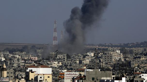 Smoke rises after an Israeli strike hits Gaza City in the northern Gaza Strip. (AP Photo/Adel Hana)