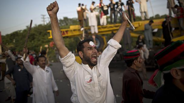 Supporters of Imran Khan protest against Pakistani prime minister Nawaz Sharif in Islamabad. (AP Photo/Muhammed Muheisen)