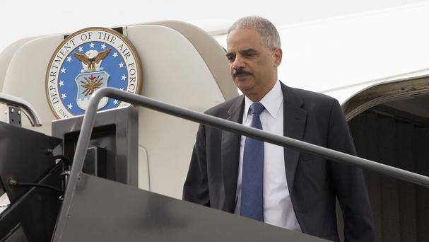 Attorney general Eric Holder arrives on a military aircraft at Lambert-St Louis International Airport (AP)
