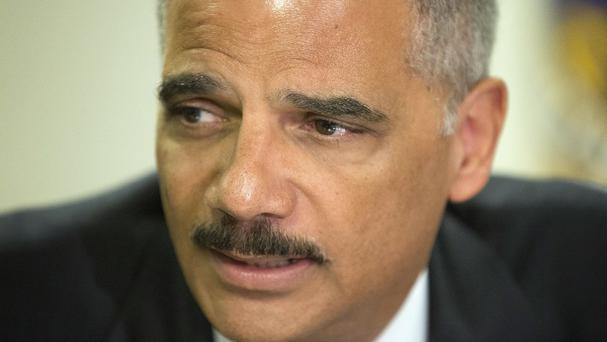 Eric Holder has assigned the government's most experienced agents to the investigation (AP)