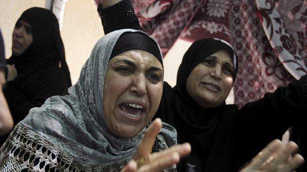 Palestinian relatives grieve during the funeral for a senior commander of the Hamas military wing, Mohammed Abu Shamaleh, who was killed in Israeli strikes (AP)