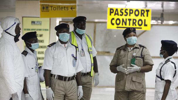 Nigerian port health officials wait to screen passengers at the arrivals hall of Murtala Muhammed International Airport in Lagos (AP)