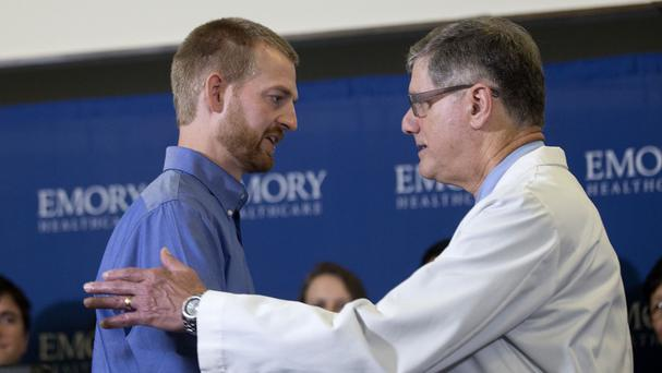 Ebola victim Dr Kent Brantly, left, embraces Dr Bruce Ribner, medical director of Emorys Infectious Disease Unit, after being released from hospital
