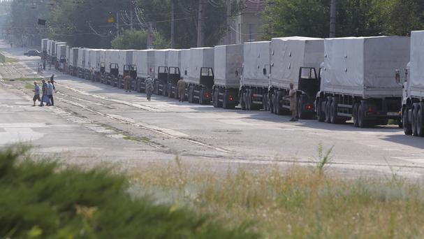 Drivers of the first trucks of the Russian convoy parked in the city of Luhansk, eastern Ukraine (AP)
