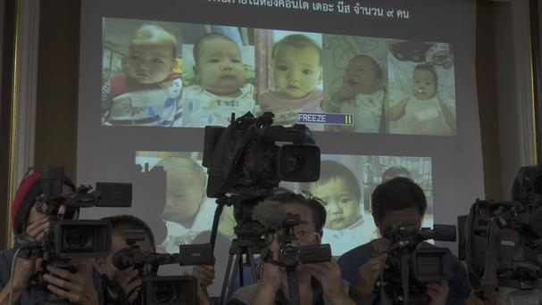 Thai police display pictures of surrogate babies born to the Japanese man at the centre of a surrogacy scandal (AP)