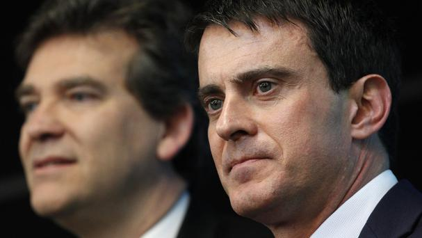 French prime minister Manuel Valls offered his Socialist government's resignation after accusing economy minister Arnaud Montebourg, left, of crossing a line with open criticism of policies (AP)