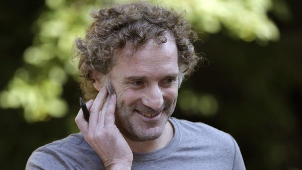 Peter Theo Curtis smiles as he talks with reporters outside his mother's home in Cambridge, Massachusetts (AP)