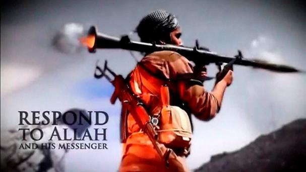 A man fires a RPG in this still image taken from an undated recruitment video for the Islamic State in Iraq and the Levant