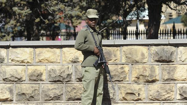 An armed soldier stands outside the military headquarters in Maseru, Lesotho (AP)