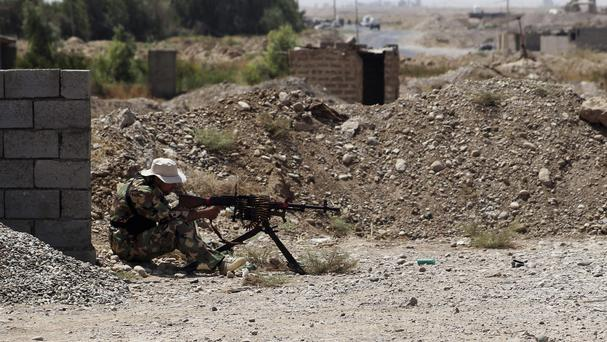 A Shiite militiaman takes his combat position in Amirli, Iraq (AP)