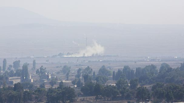 Smoke caused by fighting in Syria is seen from the Israeli-controlled Golan Heights (AP)