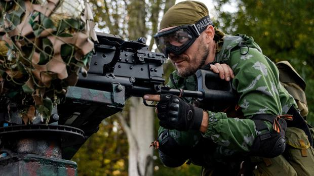 A Pro-Russian rebel prepares arms for the assault on the positions of Ukrainian army in Donetsk airport, eastern Ukraine (AP)