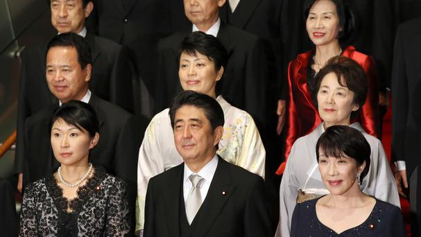 Shinzo Abe at a photocall with his new cabinet, which includes five women. (AP)