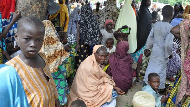 Civilians who fled their homes following an attacked by Islamist militants in Bama, take refuge at a School in Maiduguri, Nigeria (AP)
