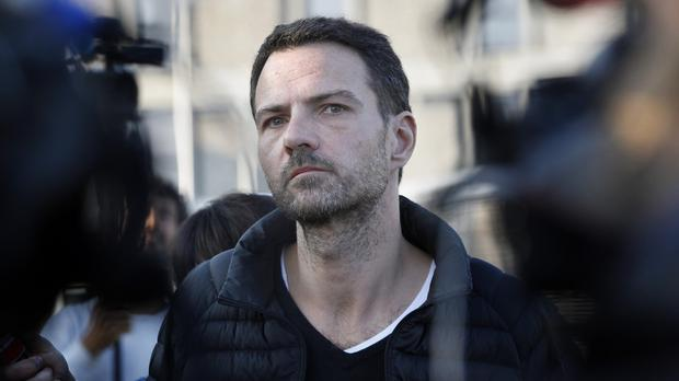 Former French trader Jerome Kerviel speaks to reporters as he leaves Fleury-Merogis prison, south of Paris (AP)