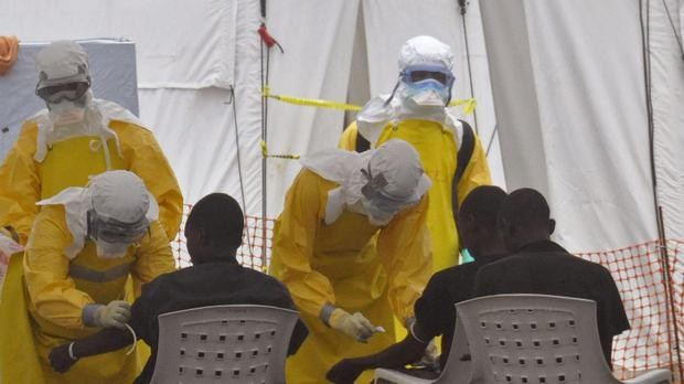 Health workers attend to patients with the Ebola virus; a fourth medic has died of the virus in Sierra Leone