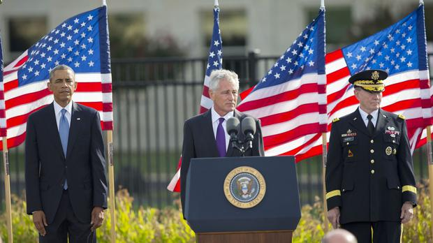From left, President Barack Obama, Defence Secretary Chuck Hagel and Joint Chiefs chairman General Martin Dempsey participate in a ceremony at the Pentagon to mark the 13th anniversary of the 9/11 attacks (AP)