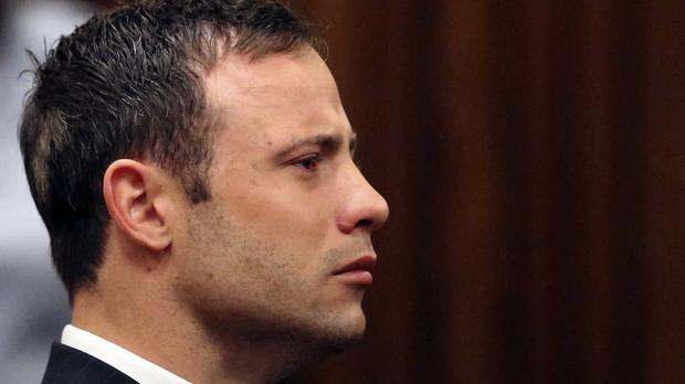 Oscar Pistorius looks straight ahead in court in Pretoria after he was found guilty of culpable homicide in the shooting death of girlfriend Reeva Steenkamp (AP)