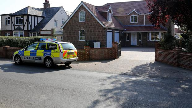 Police at a Norfolk property thought to be the home of the parents of Hannah Witheridge