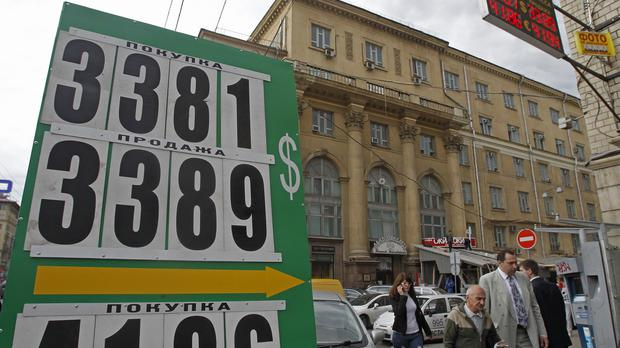 Sanctions over Ukraine have sent the Russian rouble tumbling (AP)